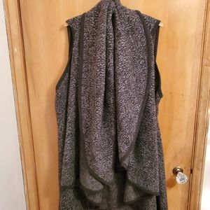 Long, thick sleeveless poncho with built in scarf